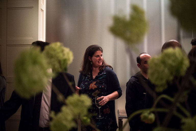 Becca Heller, 35, a founder of the International Refugee Assistance Project, attending a fund-raiser at the Seagram heir Charles Bronfman's home in New York last month. Credit Hilary Swift for The New York Times