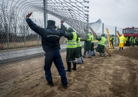 Building a fence on the border with Serbia in southern Hungary this month. Credit Sandor Ujvari/European Pressphoto Agency