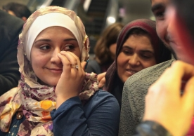 Syrian refugee Baraa Haj Khalaf wipes away a tear after arriving at O'Hare Airport with her family on a flight from Istanbul, Turkey on February 7, 2017. SCOTT OLSON VIA GETTY IMAGES